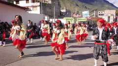 Group of dynamic dancers on the streets of Banos de Agua Santa Stock Footage