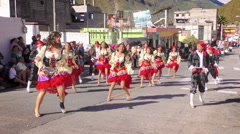 Group of dynamic dancers on the streets of Banos de Agua Santa - stock footage