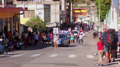 Public performance of Sagrado Corazon students on the streets of Banos De Agua Stock Footage
