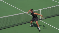 Tennis Player Volleys Over Net, turns to Camera and Celebrates. Stock Footage