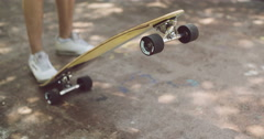Man tipping up a skateboard Stock Footage