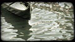 Static shot of a gondolier and his gondola. Vintage stylized video clip. Stock Footage