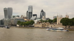 Sightseeing boat passing in front of the Tower of London Stock Footage