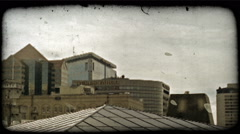 Tops of buildings 1. Vintage stylized video clip. Stock Footage