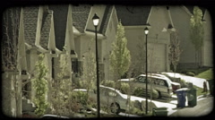 Street of identical housing units. Vintage stylized video clip. Stock Footage