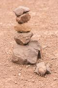 Sort stones to renew their faith. - stock photo