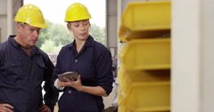 Two coworkers managing a warehouse - stock footage