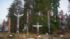 Outdoor display of seven First Nations totem poles Stock Footage