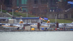 Close up of three water planes docked in Vancouver harbor Stock Footage