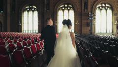 newlyweds come in the beautiful philharmonic hall slow motion - stock footage