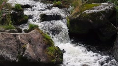 Stream flowing between rocks with authentic sound - stock footage
