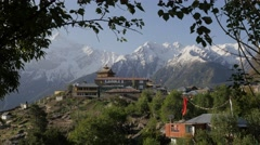 Look on village and mountains through branches,Kalpa,Kinnaur,India Stock Footage