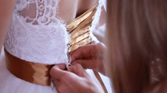 Bride getting ready. beautiful bride in white wedding dress with hairstyle and Stock Footage