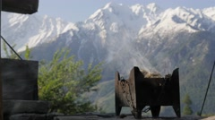Smoke at temple with mountains,Kalpa,Kinnaur,India Stock Footage