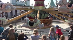 Children and adults go Carousel  in stockholm sweden - stock footage