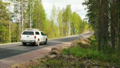 Road with cars riding through the forest Stock Footage