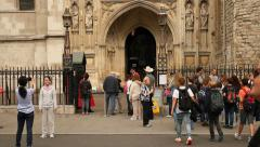 Visitors in front of Westminster Abbey, London Stock Footage