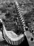 Historic machine gun with bullets over the sandbags Stock Photos