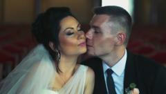 Stock Video Footage of groom kissing his bride on the cheek slow motion