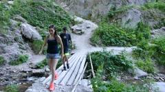 Tourists walk on a little bridge under Wonderful Bridges. Vertical view. - stock footage
