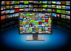 Stock Photo of TV with images on multimedia background