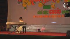 Little girl performing on synthesizer at Ho Chi Minh City in Vietnam Stock Footage