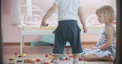 Little Boy and Girl Playing with Toy Blocks Stock Footage