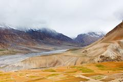 Fields in Spiti Valley in Himalayas. Himachal Pradesh, India - stock photo