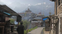 Man walking to village with mountains,Kalpa,Kinnaur,India Stock Footage