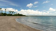 Empty beach at tropical island, calm water, panning left Stock Footage