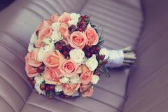 Beautiful flower bouquet on leather car seat - stock photo