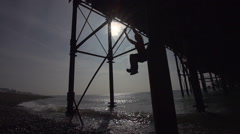 Parkour Exponant Swings Out from Pier. Stock Footage