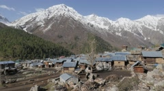 Village with snow capped mountains,Chitkul,Kinnaur,India Stock Footage