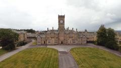 Decending aerial shot of Asylum Hospital in Yorkshire, UK Stock Footage