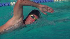 Swimmer performs the front crawl Stock Footage