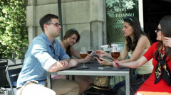 Friends using smartphones and talking together in the cafe Stock Footage