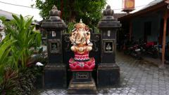 Vivid religious elephant sculpture at Balinese residence courtyard, close view Stock Footage