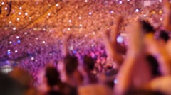Handheld shot of a crowd making party at a rock concert - stock footage