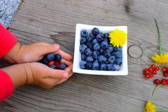 Fresh fruit in little children´s arm - stock photo
