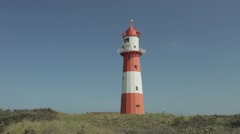 Red-white stripped lighthouse Stock Footage