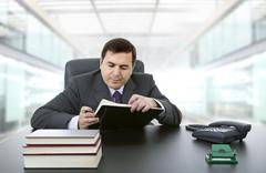 Businessman writing on a desk, at the office Stock Photos