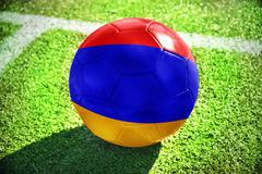 Football ball with the national flag of armenia  on the field Stock Photos