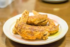 Stock Photo of Fried chicken on a white plate