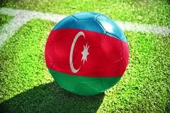 football ball with the national flag of azerbaijan on the field - stock photo