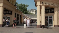 People come out of the subway. Sunny day Stock Footage