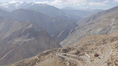 Car passes on  hairpin road in Himalaya,Nako,Kinnaur,India - stock footage