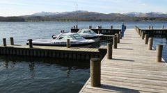 Stock Video Footage of Boats moored at a jetty at Lake Windermere, Lake District, Cumbria, UK