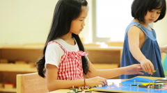 Little asian girl looking South east asia for play jigsaw on a geographical map - stock footage