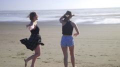 Girls dance at beach - stock footage