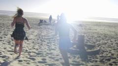 Girls run on beach Stock Footage